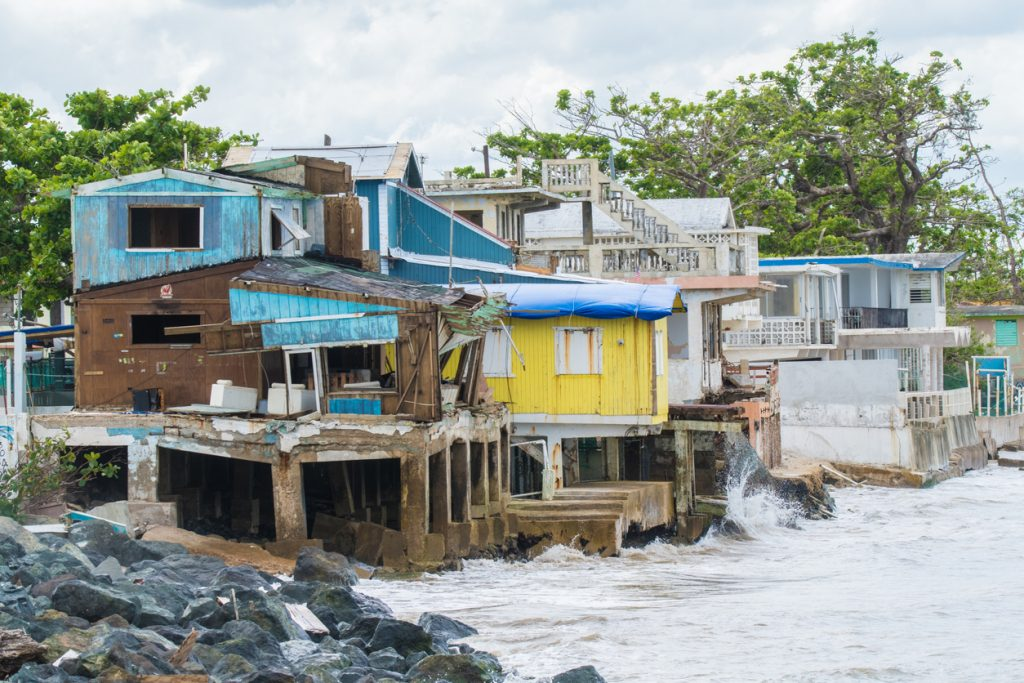 Seaside scene in Rincon, Puerto Rico after Hurricane Maria showing damage to businesses.