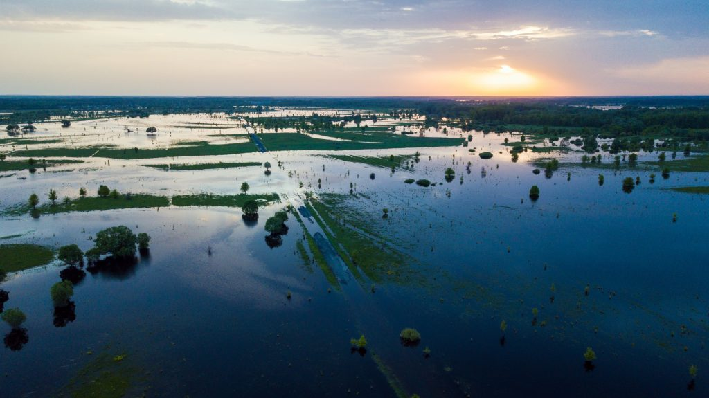 Aerial view of rural flooding at sunset